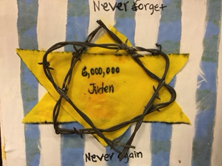 Barbed wire adorns this tile which Shayla Lords made for the Holocaust class. Photo by: Brielle Hammond.