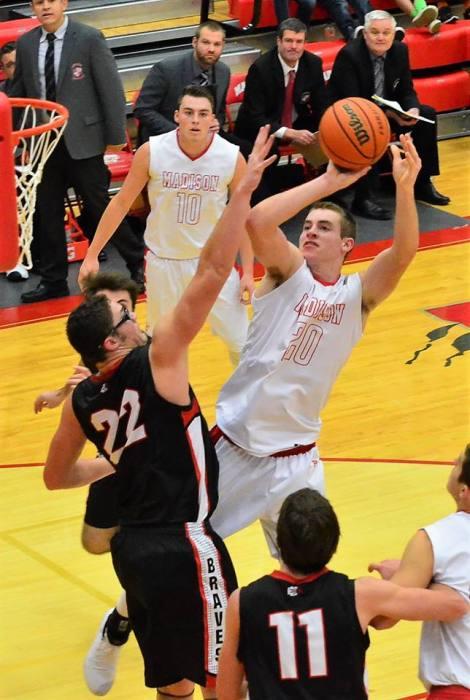David Rowe takes a shot while being pressed by the opposing team.Photo courtesy Bill Schiess