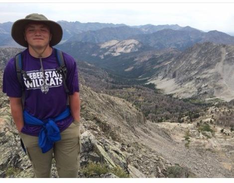 Senior Mason Bagley posing after a hike at Goat Lake