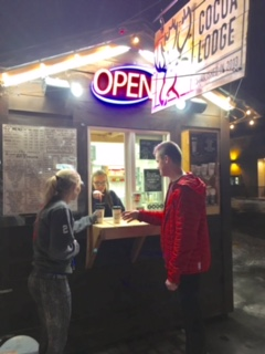 Allison Lundin and Nathan Gehmlich eagerly receive hot chocolate on a frozen night